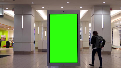 Motion of people shopping and green screen billboard in the middle inside Burnab Image