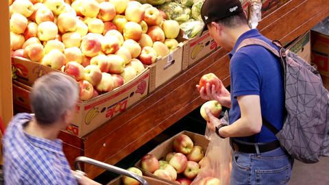 Top shot of people buying apples inside Chinese supermarket with 4k resolution Footage