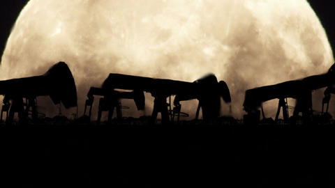 Oil Pumps on a Full Moon Background in a Polluted Environment in Zoom Out Image