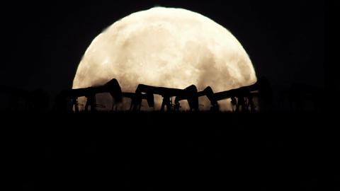Oil Pumps on a Full Moon Background in a Polluted Environment Footage