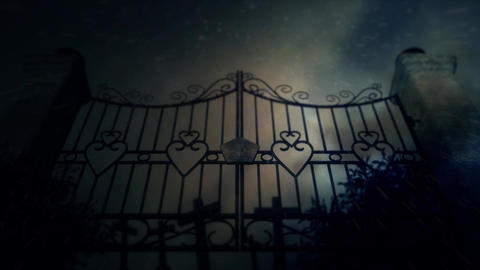 Spooky Cemetery Gates Under a Lightning Storm and Rain with Graves Footage