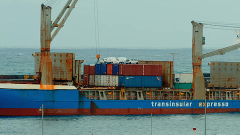 Large freight ship preparing to unload cargo Footage