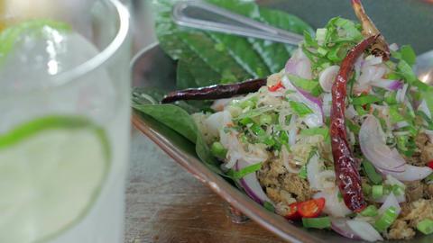 Crispy catfish salad with lemon grass and mint. Thai Food Footage