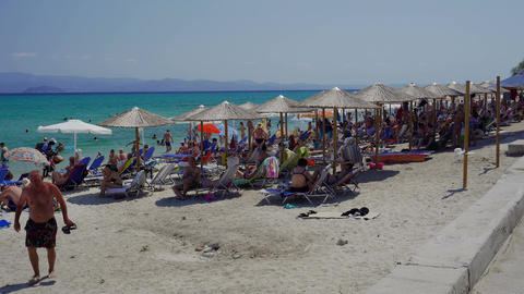 Bathers on the beach on a hot summer day at Greece Footage