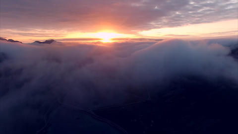 Aerial view of midnight sun above the clouds in Norway Footage