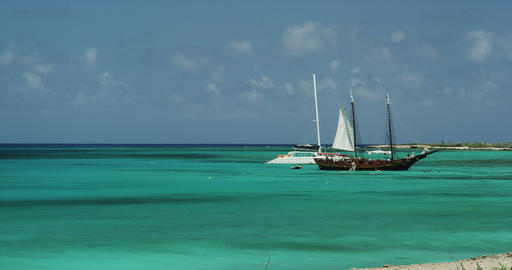 An old Sailing Boat and a modern Yacht in the Ocean Footage