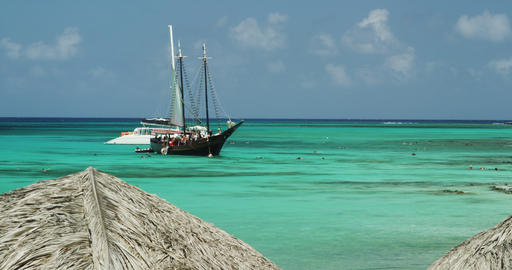 An old Sailing Boat and a modern Yacht in the Ocean ビデオ