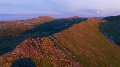 Mountain ridge on Andoya from air lit by midnight sun Footage