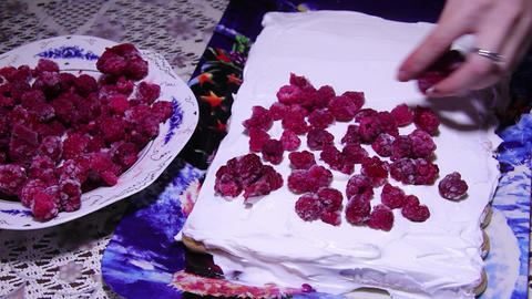 Mother Prepares A Festive Cake. The Cake Is Made Of Ladyfingers, Cream And Raspb stock footage