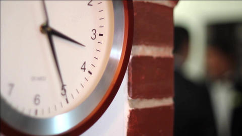 Wall clock marks time until the group of revelers will have to go to the party 4 Footage