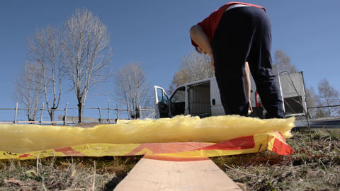Piece Of Mineral Wool Is Measured By Using A Tape, Then Cut With A Cutter In App stock footage