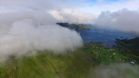 Clouds above green farmland on Lofoten, aerial Footage