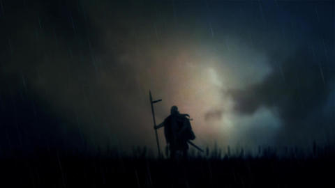 A Warrior Standing Alone in a Field Under Storm Footage