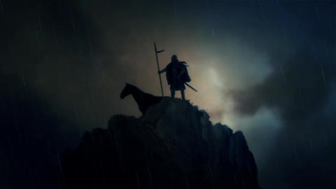 A Warrior and his Horse Standing on a Cliff Under a Lightning Storm Footage