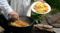 Chef puts the original Uzbek pilaf in a bowl. Cooking Uzbek pilaf Footage