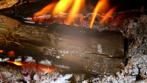 Close view at a glowing charcoal and flame in the barbecue grill. Shallow depth Footage