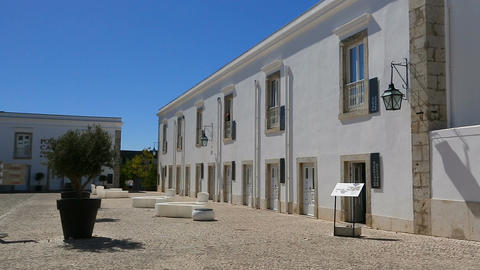 Half-empty square with buildings around in Cascais Citadel in Portugal, sequence Footage