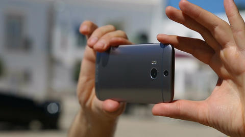 Male taking video with his mobile phone, using gadget on vacation, close-up Live Action