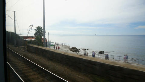 Seascape shown from train moving on railway track, summer vacation, travel Footage