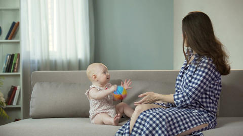 Beautiful young woman enjoying motherhood, playing with active baby, happiness Footage