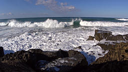 Moderate waves rolling to the rocky shore Footage