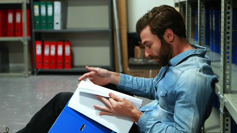 Frustrated executive reading file Live Action