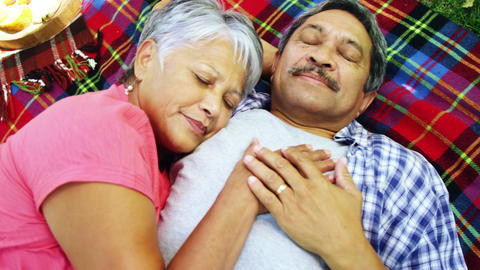 Senior couple laying on blanket Footage