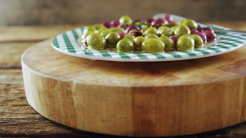Plate of pickled olives and herbs Footage