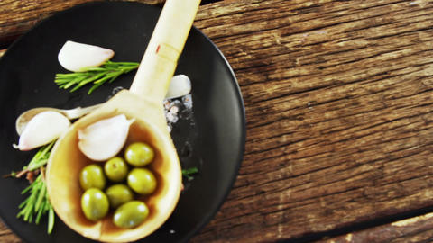 Ingredients olive and garlic kept on a black plate Footage