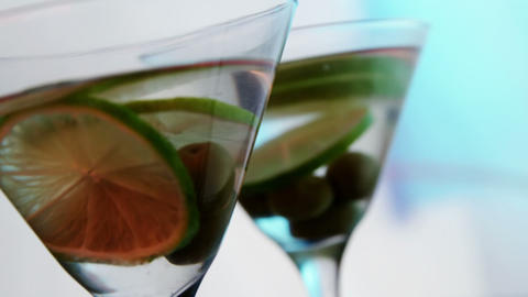 Lemon slices and olives in the glass of cocktail Footage