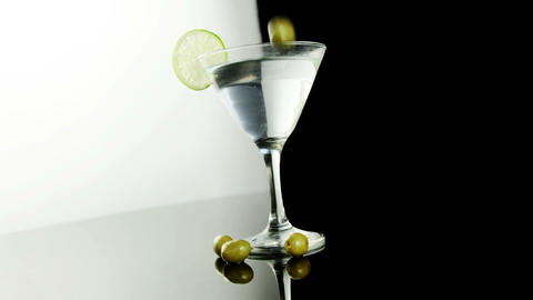 Green olives falling in the cocktail glass Footage