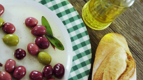 Pickled olives, oil and bread Live Action