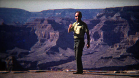 1972: Man kissing the world goodbye and jumping into Grand Canyon Footage