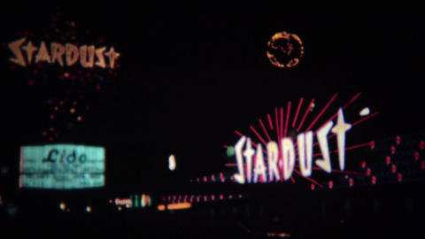 1972: Stardust hotel casino colorful neon sign shining bright at night Live Action