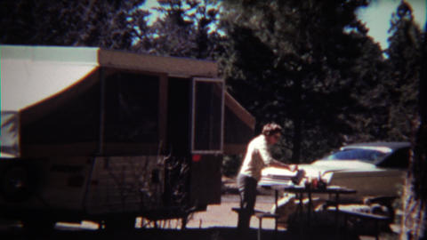 1972: Women coming out of wilderness camper to your morning coffee Footage
