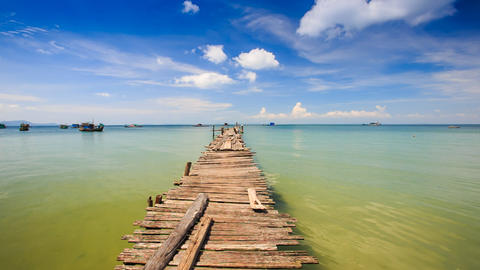 Old Wooden Pier Stretching to Azure Sea Boats at Horizon Closeup Footage