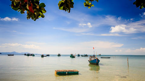 Vietnamese Boats Rock in Shallow Bay against Boats on Horizon Footage