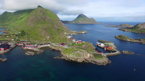 Red fishing huts in Mortsund on Lofoten islands in Norway, aerial view Footage