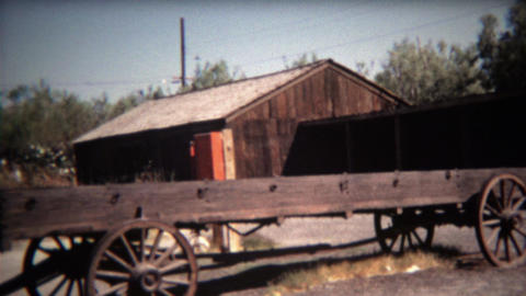 1972: Borax mining museum ruins with rusted wagon train carts Footage