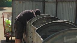 A Beggar Rummaging Through The Trash 0