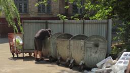 A Beggar Rummaging Through The Trash 1