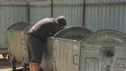 A Beggar Rummaging Through The Trash 2