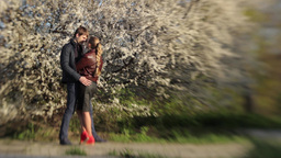 Boy and girl on a romantic date in the spring near... Stock Video Footage