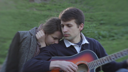 Boy and girl on a romantic date. The guy playing the guitar Stock Video Footage