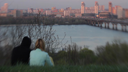 The guy with the girl sitting on the river Bank on the date Stock Video Footage