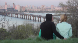 A guy and a girl on a date by the river Stock Video Footage