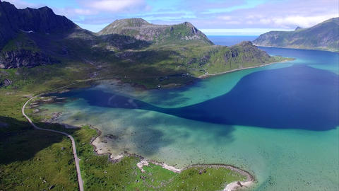 Aerial shot of scenic route around fjord on Lofoten islands in Norway Footage