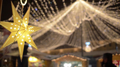 7-pointed Yellow Star Lit At A Christmas Fair Over Which Is Placed A Dome 6 stock footage