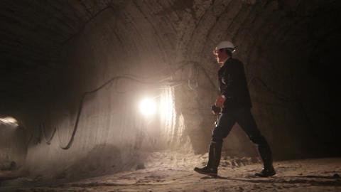Professional Worker with Lantern Walks along Underground Tunnel Footage