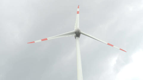 Wind turbine in motion on the cloudy sky background Energy Production Filmmaterial